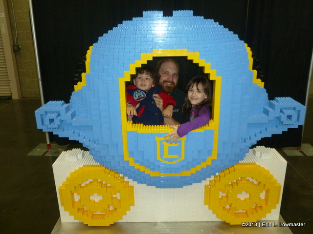 Posing inside a Cinderella Carriage made out of Duplos